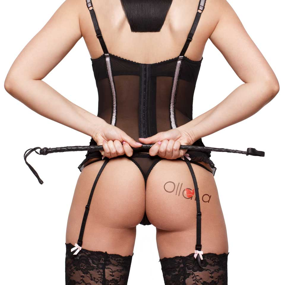 sexy domina behind with ollala logo tattoo